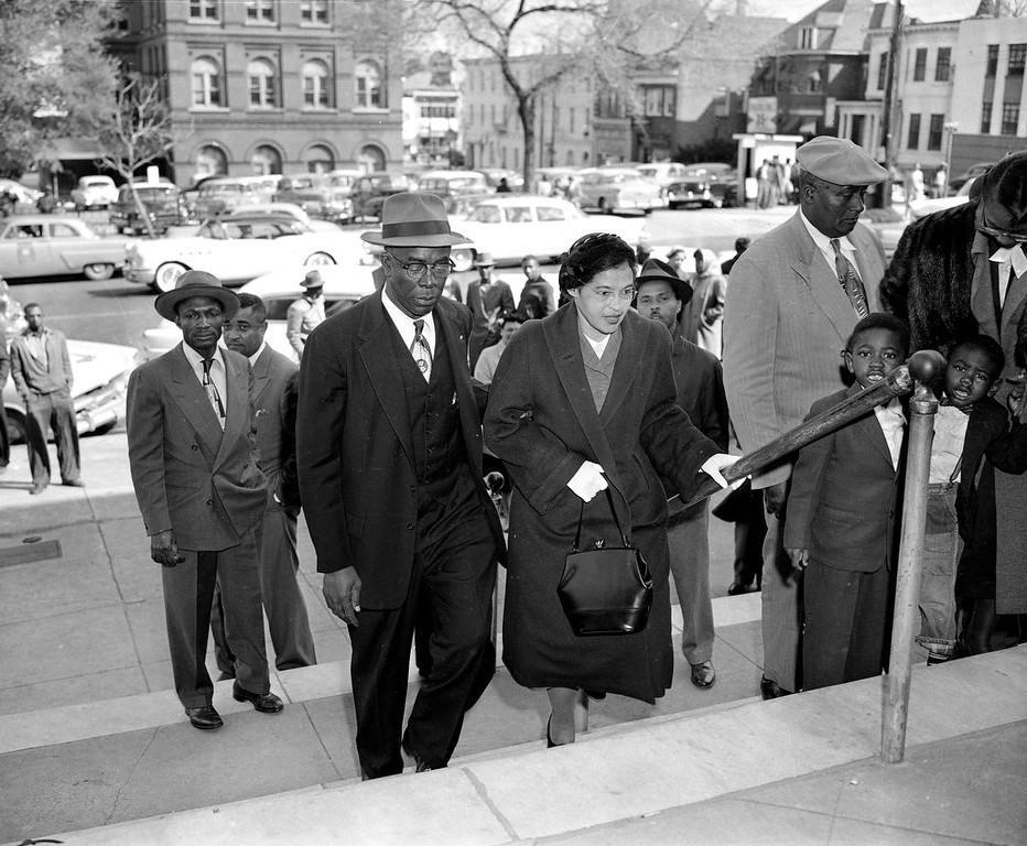 Description of . Rosa Parks is escorted by E.D. Nixon, former president of the Alabama NAACP, on arrival at the courthouse in Montgomery March 19, 1956 for the trial in the racial bus boycott.  Mrs. Parks was fined $14 on Dec. 5 for failing to give up her seat for a white passenger on a city bus.  The bus boycott started on the day she was fined.  There were 91 other defendants.  (AP Photo/Gene Herrick)