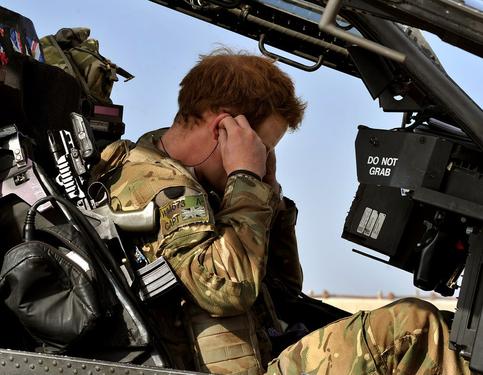Description of . In this image released on January 22, 2013, Prince Harry, sits in the cockpit at as he prepares for a mission at the British controlled flight-line at Camp Bastion on October 31, 2012 in Afghanistan. Prince Harry has served as an Apache Helicopter Pilot/Gunner with 662 Sqd Army Air Corps, from September 2012 for four months until January 2013.  (Photo by John Stillwell - WPA Pool/Getty Images)