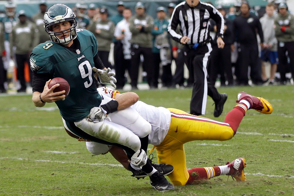 Description of . Philadelphia Eagles quarterback Nick Foles (9) is sacked by Washington Redskins strong safety Reed Doughty during the first half of an NFL football game in Philadelphia, Sunday, Nov. 17, 2013. (AP Photo/Matt Rourke)