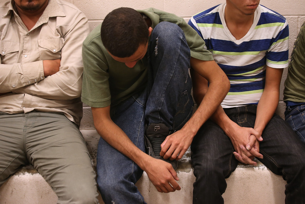 Description of . MCALLEN, TX - APRIL 11:  Male undocumented immigrants rest at the U.S. Border Patrol detainee processing center on April 11, 2013 in McAllen, Texas. In the last month the Border Patrol\'s Rio Grande Valley sector has seen a spike in the number of immigrants crossing the river from Mexico into Texas. With more apprehensions, they have struggled to deal with overcrowding while undocumented immigrants are processed for deportation. According to the Border Patrol, undocumented immigrant crossings have increased more than 50 percent in Texas\' Rio Grande Valley sector in the last year. Border Patrol agents say they have also seen an additional surge in immigrant traffic since immigration reform negotiations began this year in Washington D.C. Proposed reforms could provide a path to citizenship for many of the estimated 11 million undocumented workers living in the United States.  (Photo by John Moore/Getty Images)