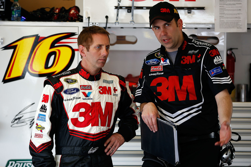 . DAYTONA BEACH, FL - FEBRUARY 20:  Greg Biffle (L), driver of the #16 3M FordMobil 1/Burger King, talks with crew chief Matt Puccia (R) in the garage during practice for the NASCAR Sprint Cup Series Daytona 500 at Daytona International Speedway on February 20, 2013 in Daytona Beach, Florida.  (Photo by Chris Graythen/Getty Images)