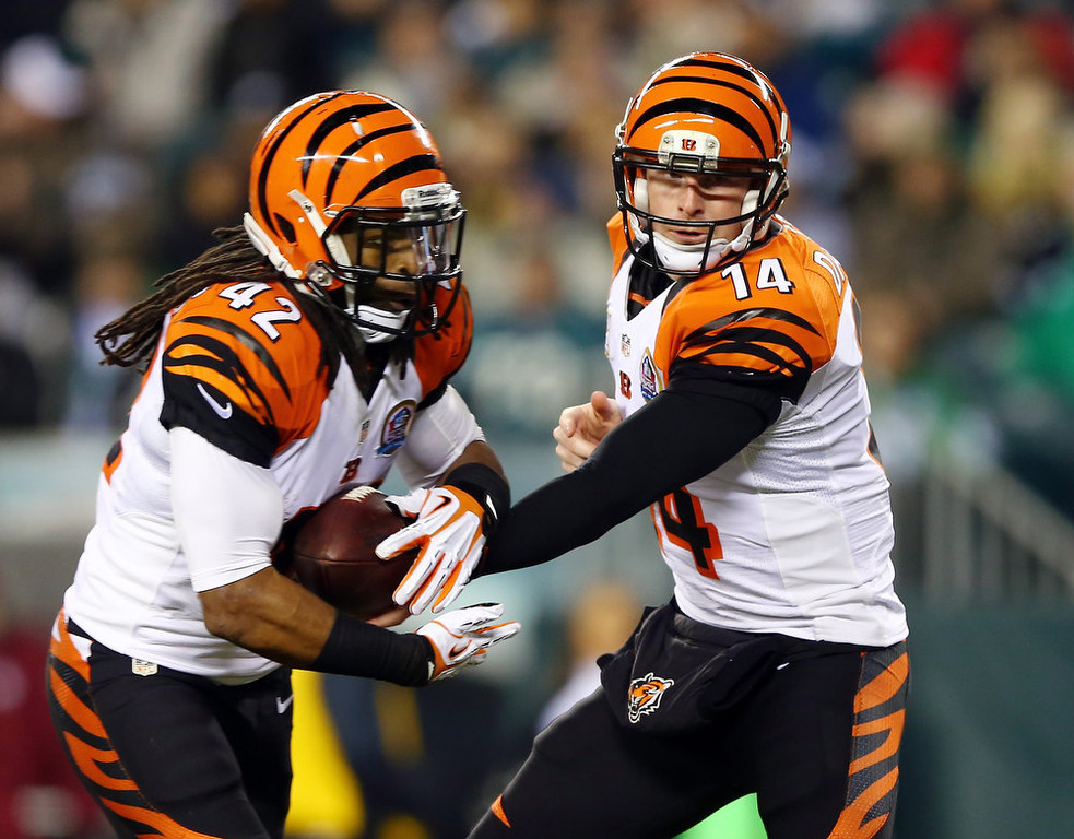 Description of . Andy Dalton #14 of the Cincinnati Bengals hands the ball off to  BenJarvus Green-Ellis #42 in the first quarter against the Philadelphia Eagles on December 13, 2012 at Lincoln Financial Field in Philadelphia, Pennsylvania.  (Photo by Elsa/Getty Images)
