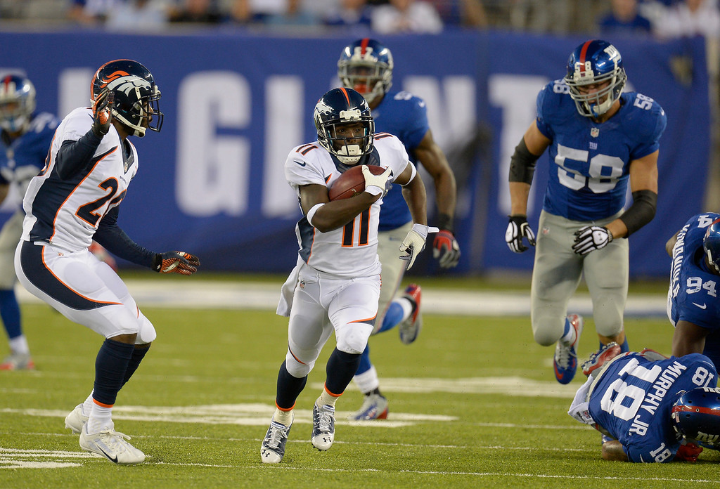 Description of . Denver Broncos wide receiver Trindon Holliday (11) out runs the New York Giants special teams on an 81 yard punt return for a touchdown during the fourth quarter September 15, 2013 MetLife Stadium. (Photo by John Leyba/The Denver Post)