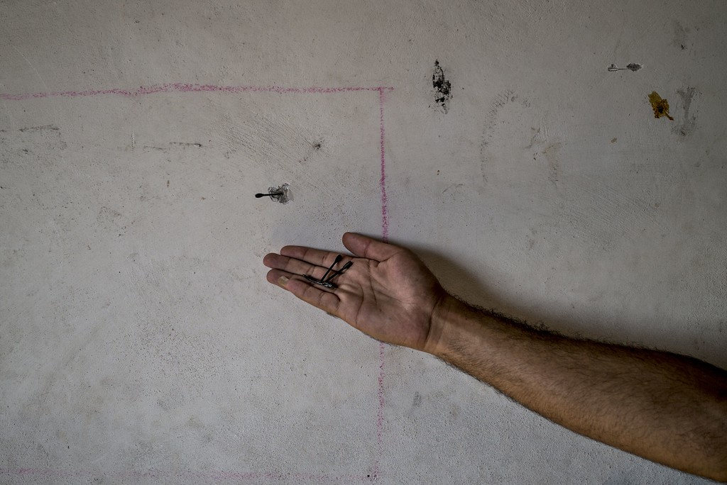 Description of . A Palestinian man from Gaza Strip's central Bureij refugee camp holds in the palm of his hand some flechettes, as one is seen stuck in the wall of his house, while he inspects it on August 1, 2014. Israel declared an end to a three-day Gaza truce only hours after it began today, saying it fears a soldier was captured, jeopardising international efforts for a durable ceasefire. AFP PHOTO/MARCO LONGARI/AFP/Getty Images