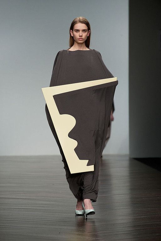 Description of . LONDON, ENGLAND - FEBRUARY 15:  A model walks the runway at the Central Saint Martins MA show during London Fashion Week Fall/Winter 2013/14 at Somerset House on February 15, 2013 in London, England.  (Photo by Felix Kunze/Getty Images)