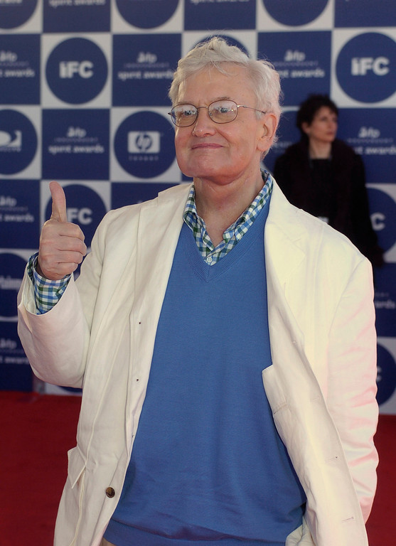 Description of . Film critic Roger Ebert gives a thumbs up as he arrives for the 2004 IFP Independent Spirit Awards on In Santa Monica, Calif., on Saturday, Feb. 28, 2004. (AP Photo/Chris Pizzello)