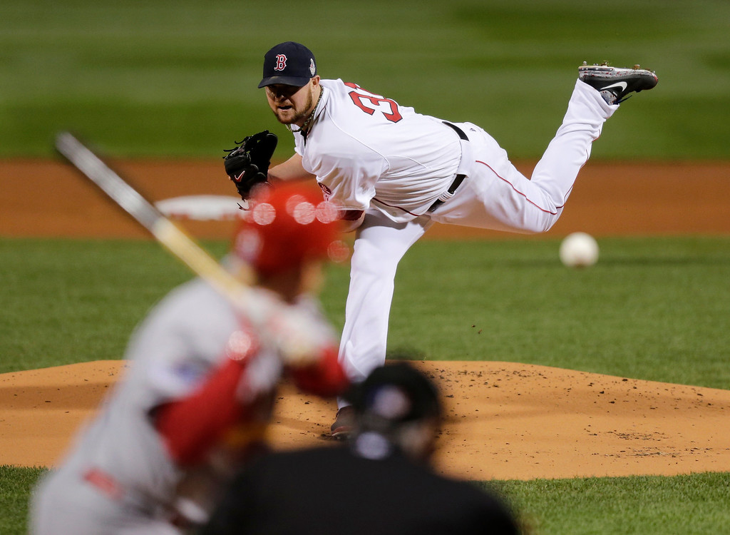 Description of . Boston Red Sox starting pitcher Jon Lester throws during the first inning of Game 1 of baseball's World Series against the St. Louis Cardinals Wednesday, Oct. 23, 2013, in Boston. (AP Photo/Charles Krupa)