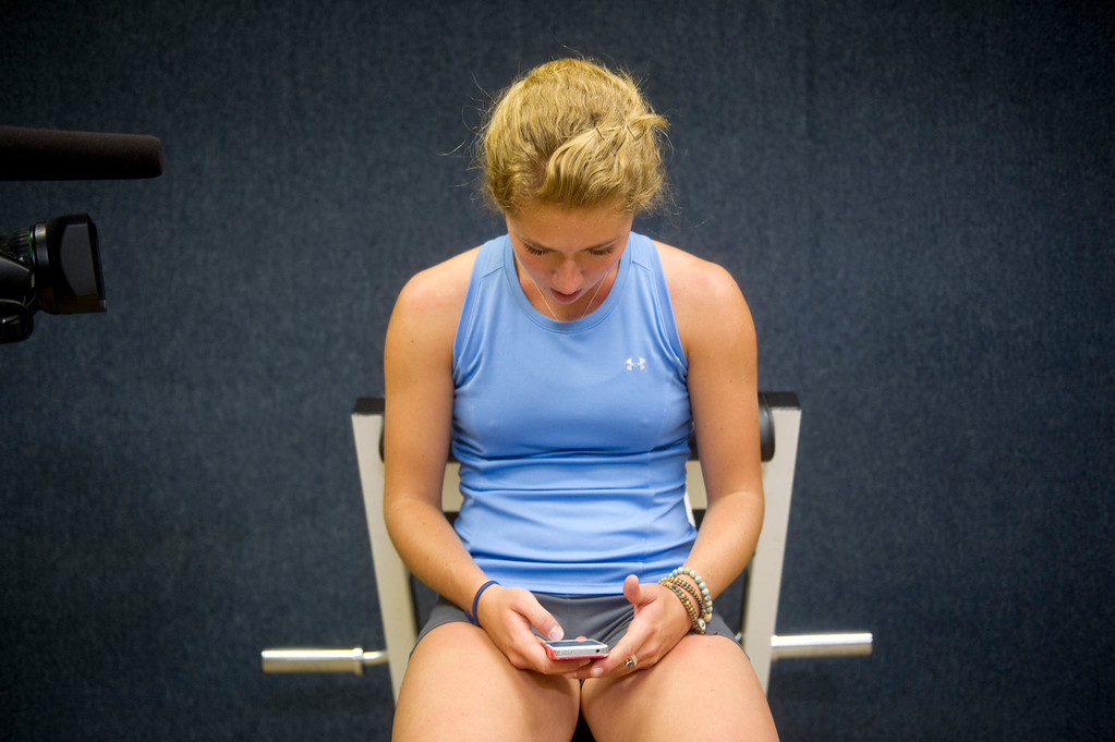 Description of . A Fox Sports video camera films Olympic downhill skier Mikaela Shiffrin while she follows directions on her phone during a morning workout at the Homestead Club in Edwards, Co. on July 15, 2013. (Photo By Grant Hindsley/The Denver Post)