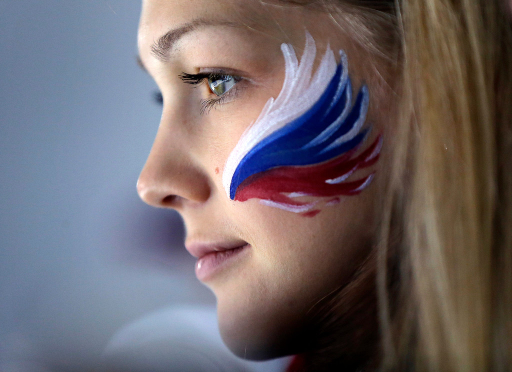 Description of . A Russian fan wears face paint while attending men's curling competition at the 2014 Winter Olympics, Monday, Feb. 17, 2014, in Sochi, Russia. (AP Photo/Robert F. Bukaty)