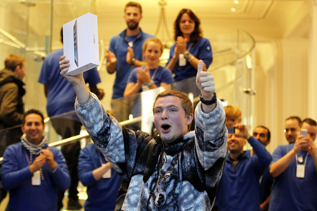 Description of . The first customer of the tablet iPad in an Apple Store in Amsterdam gestures on November 1, 2013.  Apple's share of the tablet market fell to its lowest point on record in the third quarter, ahead of the launch of its new iPads, a survey showed on October 31, 2013. Research firm IDC's survey said Apple's market share slid to 29.6 percent, its lowest share since it fueled the tablet craze with its first iPads. AFP PHOTO / ANP  BAS CZERWINSKI/AFP/Getty Images
