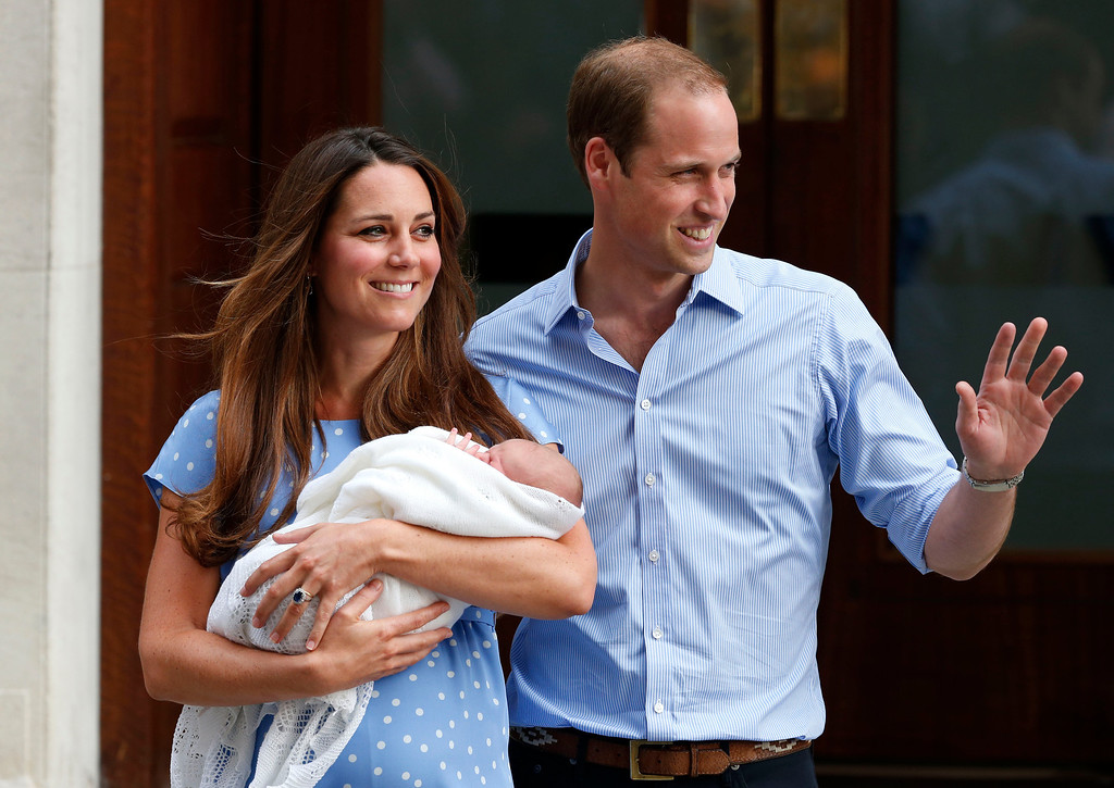 Description of . Britain's Prince William and Kate, Duchess of Cambridge hold the Prince of Cambridge, Tuesday July 23, 2013, as they pose for photographers outside St. Mary's Hospital exclusive Lindo Wing in London where the Duchess gave birth.  (AP Photo/Lefteris Pitarakis)