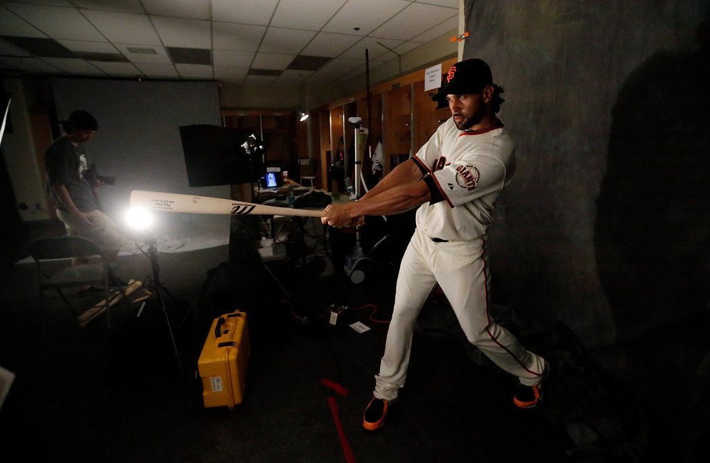 Description of . San Francisco Giants' Angel Pagan poses for a picture during baseball spring training photo day Wednesday, Feb. 20, 2013 in Scottsdale, Ariz. (AP Photo/Morry Gash)