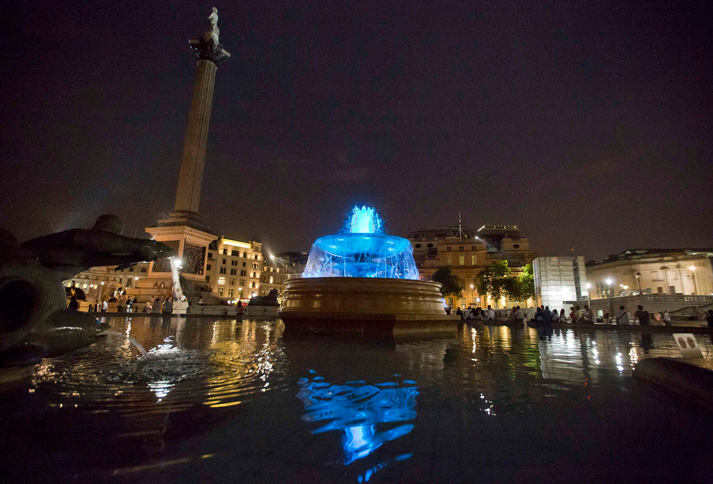 Description of . The fountains at Trafalgar Square are seen lit blue to signify the birth of a baby boy to Britain\'s Prince William and Catherine, Duchess of Cambridge in London July 22, 2013.  Prince William\'s wife Kate gave birth, in the Lindo Wing of St Mary\'s Hospital,  on Monday to a baby boy who becomes third in line to the British throne. The royal baby, the couple\'s first child, was born at 4:24 p.m., weighing 8 lbs and 6 oz. REUTERS/Neil Hall
