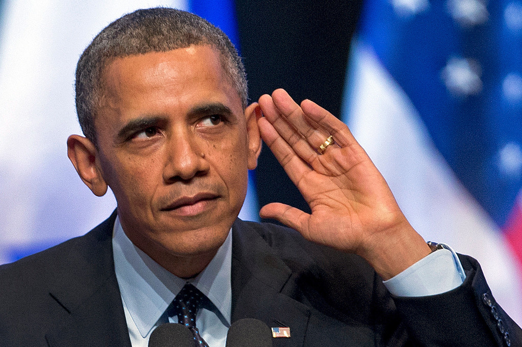 Description of . President Barack Obama looks into the crowd and tries to hear a person yelling at him during his speech at the International Convention Center in Jerusalem, Thursday, March 21, 2013. (AP Photo/Carolyn Kaster)