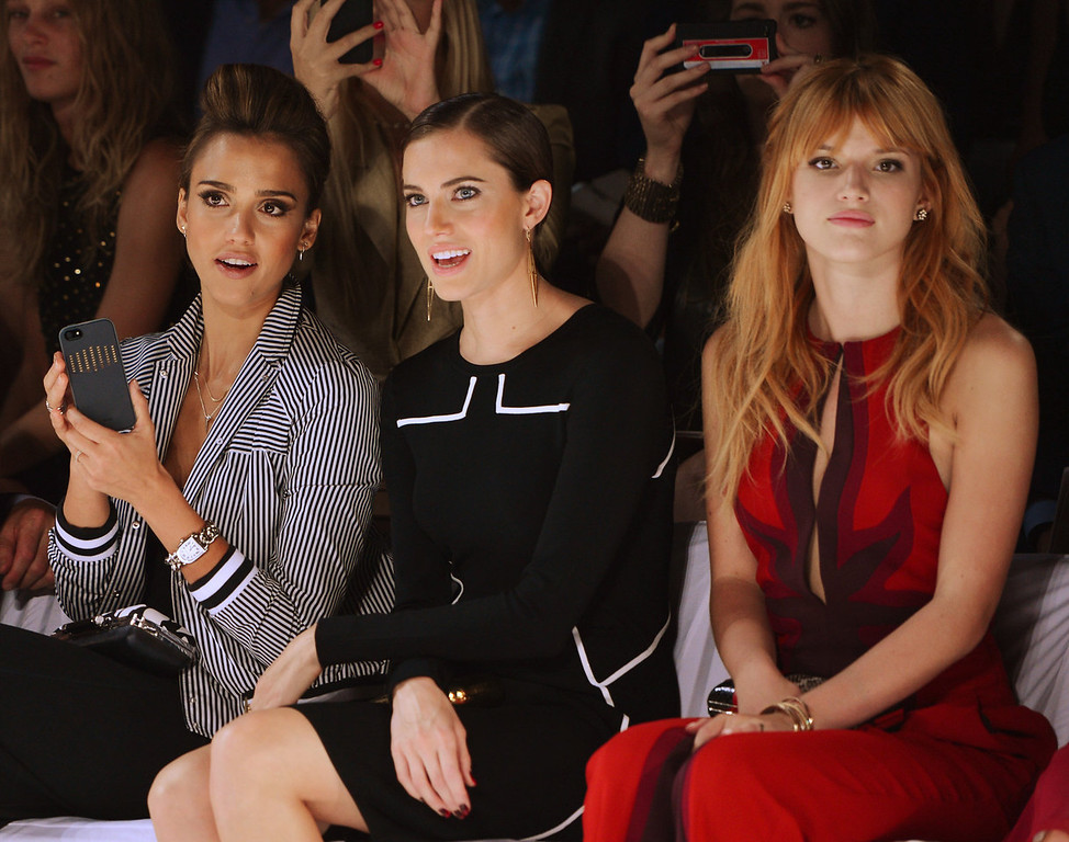 Description of . (L-R) Jessica Alba, Allison Williams and Holland Roden attend the Diane Von Furstenberg fashion show during Mercedes-Benz Fashion Week Spring 2014 at The Theatre at Lincoln Center on September 8, 2013 in New York City.  (Photo by Stephen Lovekin/Getty Images for Mercedes-Benz Fashion Week Spring 2014)