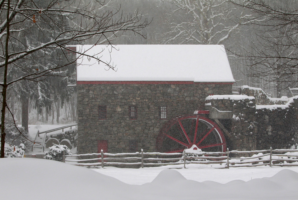 Description of . Snow blankets a grist mill at Longfellow's Wayside Inn Wednesday, Feb. 5, 2014, in Sudbury, Mass. Up to a foot of snow was predicted throughout the day in some parts of Massachusetts.   (AP Photo/Bill Sikes)