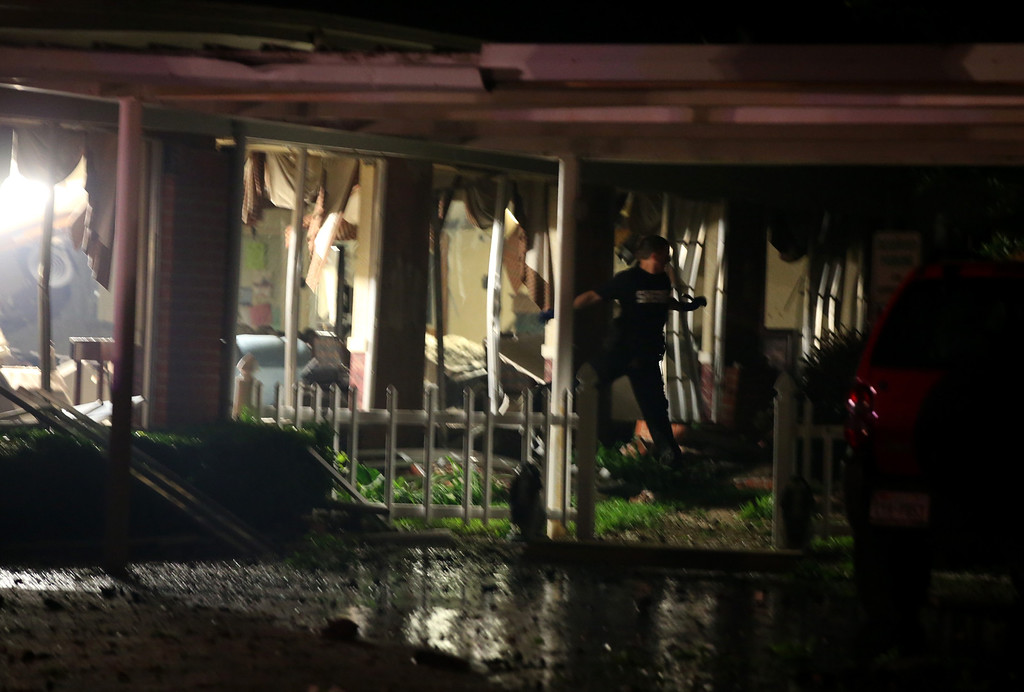 Description of . An emergency worker walks through damaged apartment building following a fertilizer plant explosion Wednesday, April 17, 2013, in West, Texas. An explosion at a fertilizer plant near Waco Wednesday night injured dozens of people and sent flames shooting high into the night sky, leaving the factory a smoldering ruin and causing major damage to surrounding buildings. (AP Photo/ Waco Tribune Herald, Rod Aydelotte)