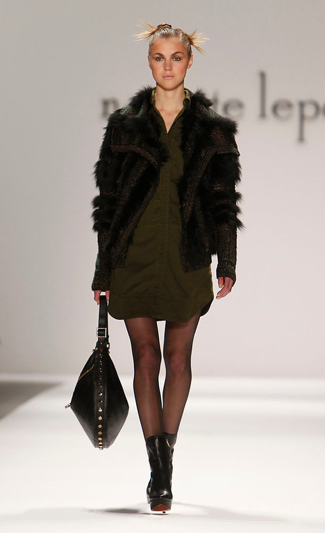 Description of . The Nanette Lepore Fall 2013 collection is modeled during Fashion Week, Wednesday, Feb. 13, 2013 in New York. (AP Photo/Jason DeCrow)