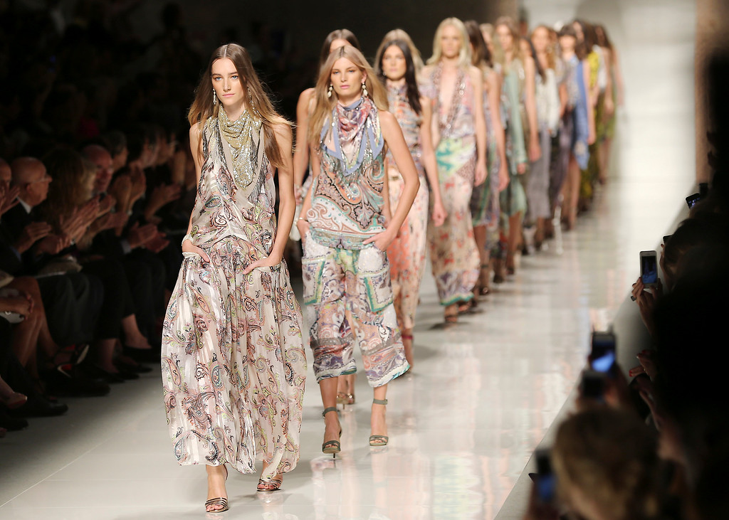 Description of . Models wear creations for Etro women's Spring-Summer 2014 collection, part of the Milan Fashion Week, unveiled in Milan, Italy, Friday, Sept. 20, 2013. (AP Photo/Antonio Calanni)