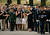 Family, friends and fellow soldiers salute as US Army 1st Lt. Mark Harold Dooley remains are carried to the graveside during his funeral at Arlington National Cemetery July 13, 2007 in Arlington, Virginia.  A member of the Army National Guard's 3rd Battalion, 172nd Infantry Regiment (Mountain), 42nd Infantry Division, Dooley died in Ramadi, Iraq, when an improvised explosive device detonated near his vehicle during patrol operations on September 19, 2005.  (Photo by Chip Somodevilla/Getty Images)