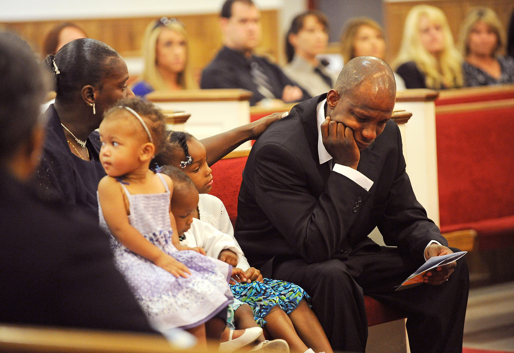 Description of . Corinthiah Brown comforts her son, Torrey Brown Sr., during a memorial service for his son, Torrey Brown Jr., Friday June 15, 2012, at Odom Memorial Church of God in Christ, in Denver, CO. RJ Sangosti, The Denver Post