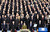 South Korea's new President Park Geun-hye, front row center, sings the national anthem during her inauguration ceremony as the 18th South Korean president in Seoul, South Korea, Monday, Feb. 25, 2013.  (AP Photo/Lee Jin-man)