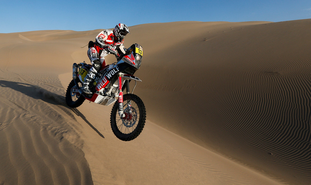 Description of . Honda rider Gerard Farres Guell of Spain competes in the 4nd stage of the 2013 Dakar Rally from Nazca to Arequipa, Peru, Tuesday, Jan. 8, 2013. The race finishes in Santiago, Chile, on Jan. 20. (AP Photo/Victor R. Caivano)