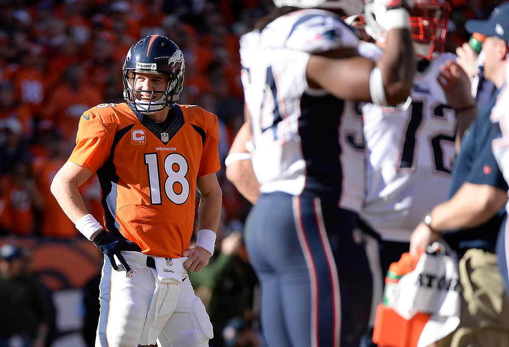 Description of . Denver Broncos quarterback Peyton Manning (18) in the second quarter. The Denver Broncos take on the New England Patriots in the AFC Championship game at Sports Authority Field at Mile High in Denver on January 19, 2014. (Photo by AAron Ontiveroz/The Denver Post)