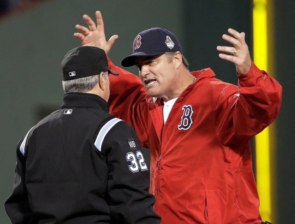 Description of . Boston Red Sox manager John Farrell argues a call with umpire Dana DeMuth during the first inning of Game 1 of baseball's World Series against the St. Louis Cardinals  Wednesday, Oct. 23, 2013, in Boston. (AP Photo/David J. Phillip)