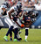 Chicago Bears wide receiver Brandon Marshall (15) is tackled by Seattle Seahawks cornerback Brandon Browner (L) and free safety Earl Thomas (29) during the first half of their NFL football game at Soldier Field in Chicago December 2, 2012.  REUTERS/Jeff Haynes