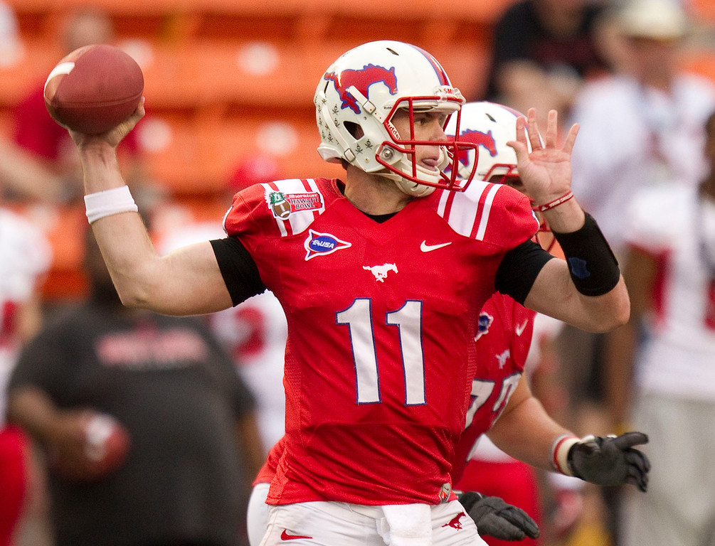 Description of . SMU quarterback Garrett Gilbert drops back to pass against Fresno State in the third quarter of the Hawaii Bowl, an NCAA college football game Monday, Dec. 24, 2012, in Honolulu. (AP Photo/Eugene Tanner)