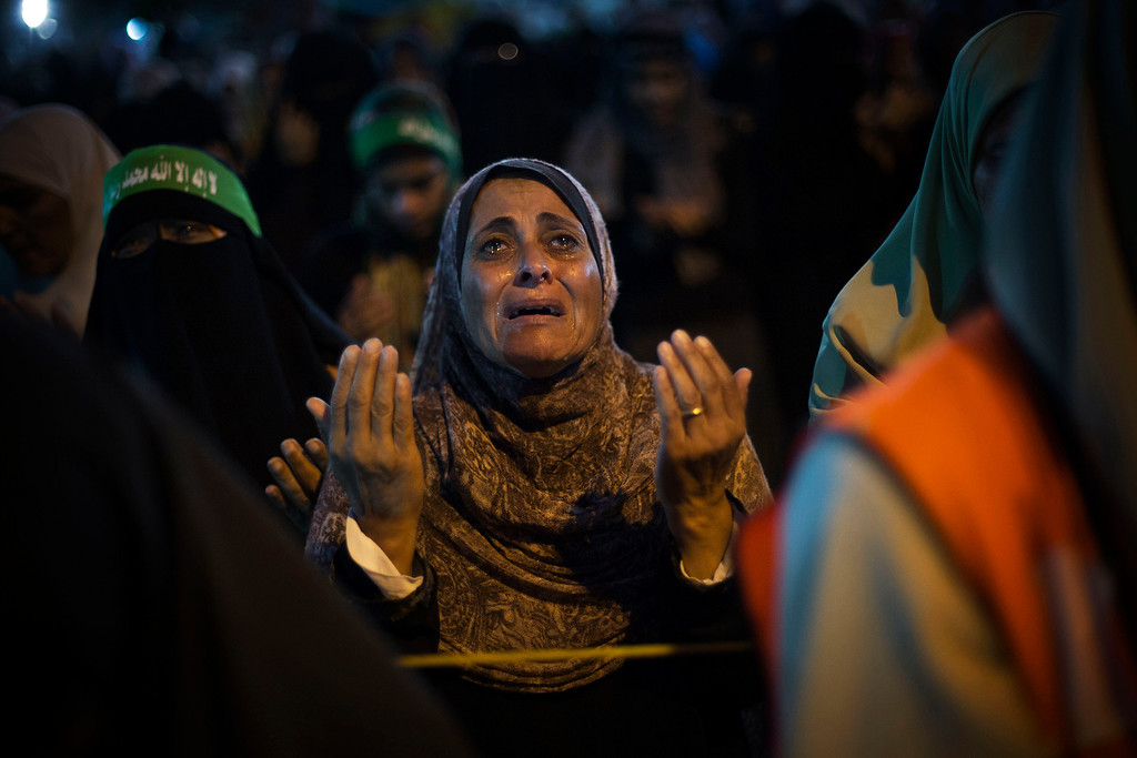 Description of . A supporter of Egypt's ousted President Mohammed Morsi reacts while praying during a protest against Egyptian Defense Minister Gen. Abdel-Fattah el-Sissi  in Nasr City, Cairo, Egypt, Friday, Aug. 2, 2013. (AP Photo/Manu Brabo)