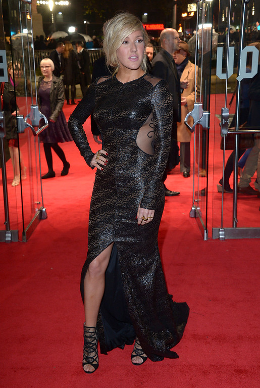 Description of . Singer Ellie Goulding poses for photographers as she arrives for the World Premiere of 'The Hunger Games: Catching Fire', on Monday Nov. 11, 2013, in Leicester Square, London. 'Catching Fire' is the second installment in 'The Hunger Games' trilogy. (Photo by Jon Furniss/Invision/AP)