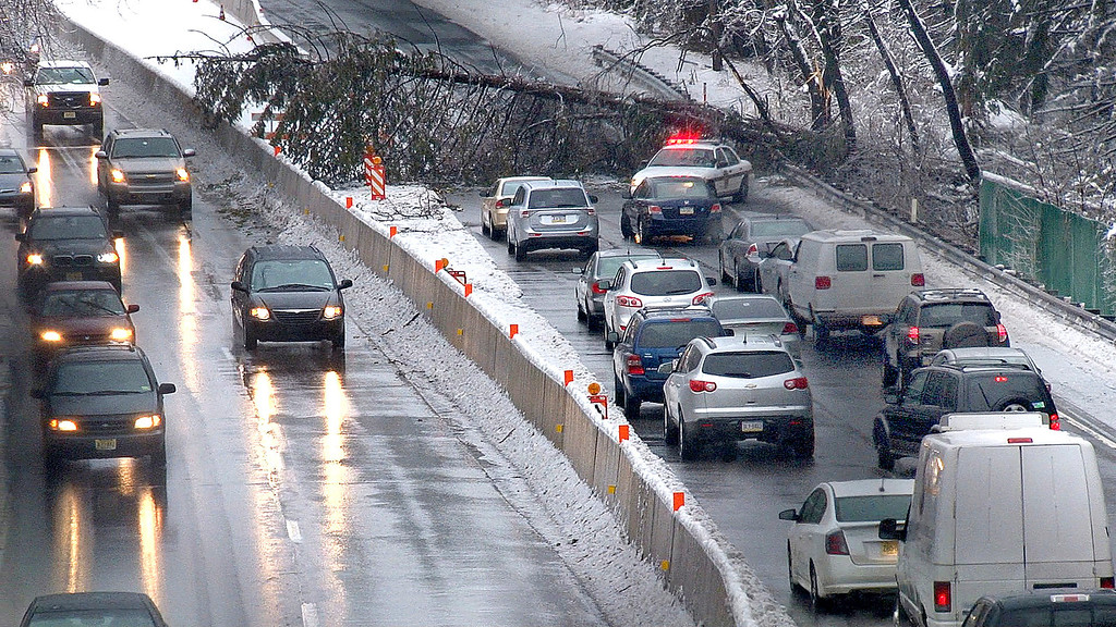 Description of . Southbound traffic  backs up after a tree fell across U.S. 1 in Langhorne, Bucks County, Pa., Wednesday morning, Feb. 5, 2013. Traffic was stopped for over two hours. Icy condition ssnarled traffic and caused power outages Wednesday.  (AP Photo/Bucks County Courier Times,David Garrett )