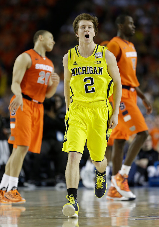 Description of . Michigan's Spike Albrecht (2) reacts to play against Syracuse during the first half of the NCAA Final Four tournament college basketball semifinal game Saturday, April 6, 2013, in Atlanta. (AP Photo/Charlie Neibergall)
