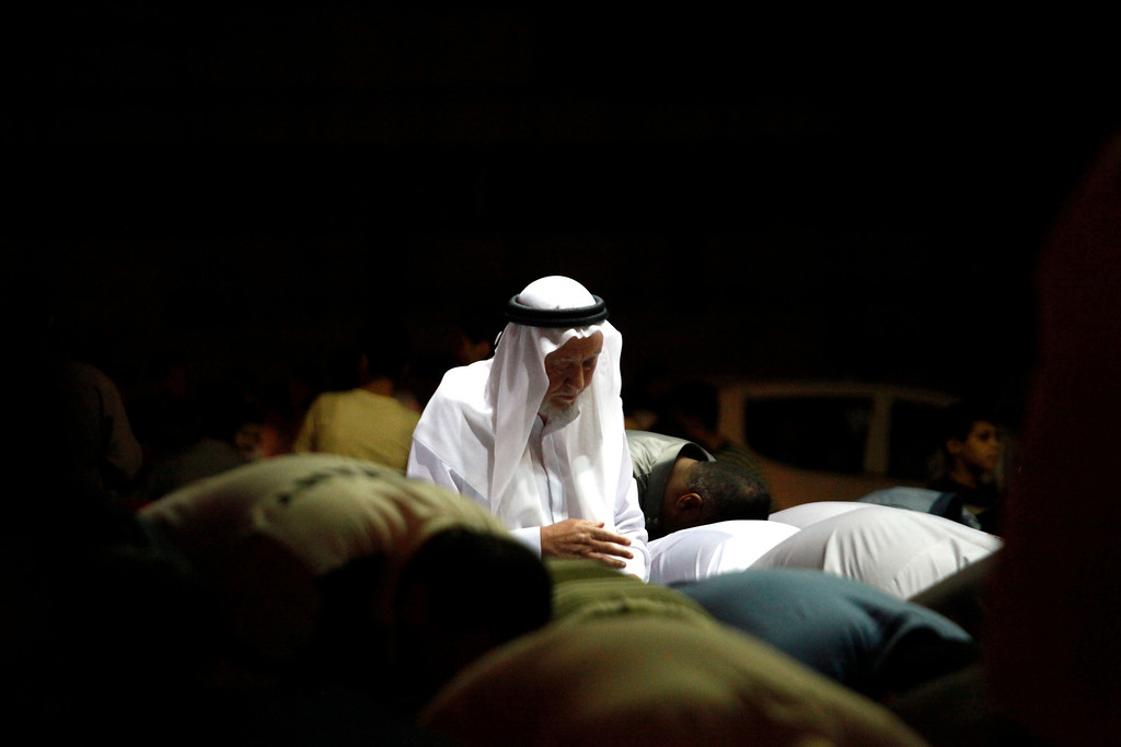 Description of . FILE - Hamza Mansour, secretary general of the Islamic Action Front, joins Syrians living in Amman, Jordan, for their Ramadan prayers in front of the Syrian embassy, as they call for Syrian President Bashar Assad to step down, Friday, Aug. 26, 2011. (AP Photo/Mohammad Hannon, File)
