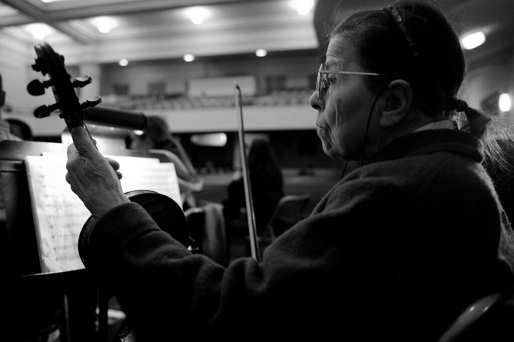 Description of . DENVER, CO - NOVEMBER 4: Pauline Dallenbach rehearses with the Denver Philharmonic Orchestra at the KPOF Hall in Denver, Colorado on November 4, 2013. Pauline Dallenbach is celebrating her 50th year in the Denver Philharmonic Orchestra, even in her late 80s, she still attends every rehearsal, concert and board meeting. (Photo by Seth McConnell/The Denver Post)