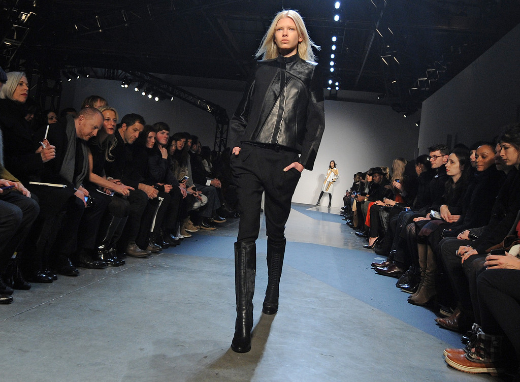 Description of . The Helmut Lang Fall 2013 collection is modeled during Fashion Week, Friday, Feb. 8, 2013, in New York. (AP Photo/Louis Lanzano)