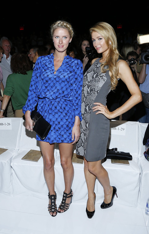 Description of . Nicky Hilton (L) and Paris Hilton attend the Diane Von Furstenberg fashion show during Mercedes-Benz Fashion Week Spring 2014 at The Theatre at Lincoln Center on September 8, 2013 in New York City.  (Photo by Cindy Ord/Getty Images for Mercedes-Benz Fashion Week Spring 2014)
