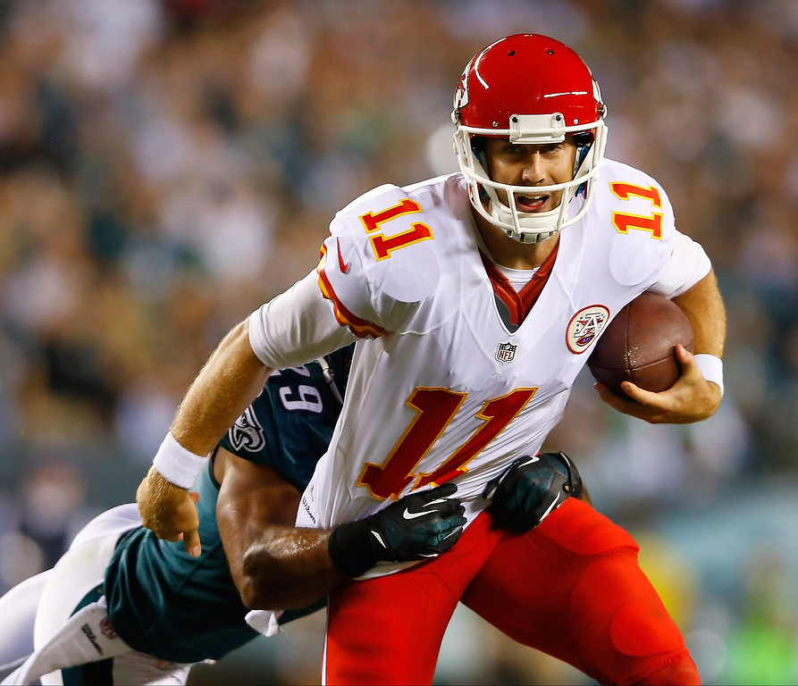 Description of . Alex Smith #11 of the Kansas City Chiefs tries to avoid being sacked by  Nate Allen #29 of the Philadelphia Eagles in the first quarter at Lincoln Financial Field on September 19, 2013 in Philadelphia, Pennsylvania.  (Photo by Rich Schultz/Getty Images)
