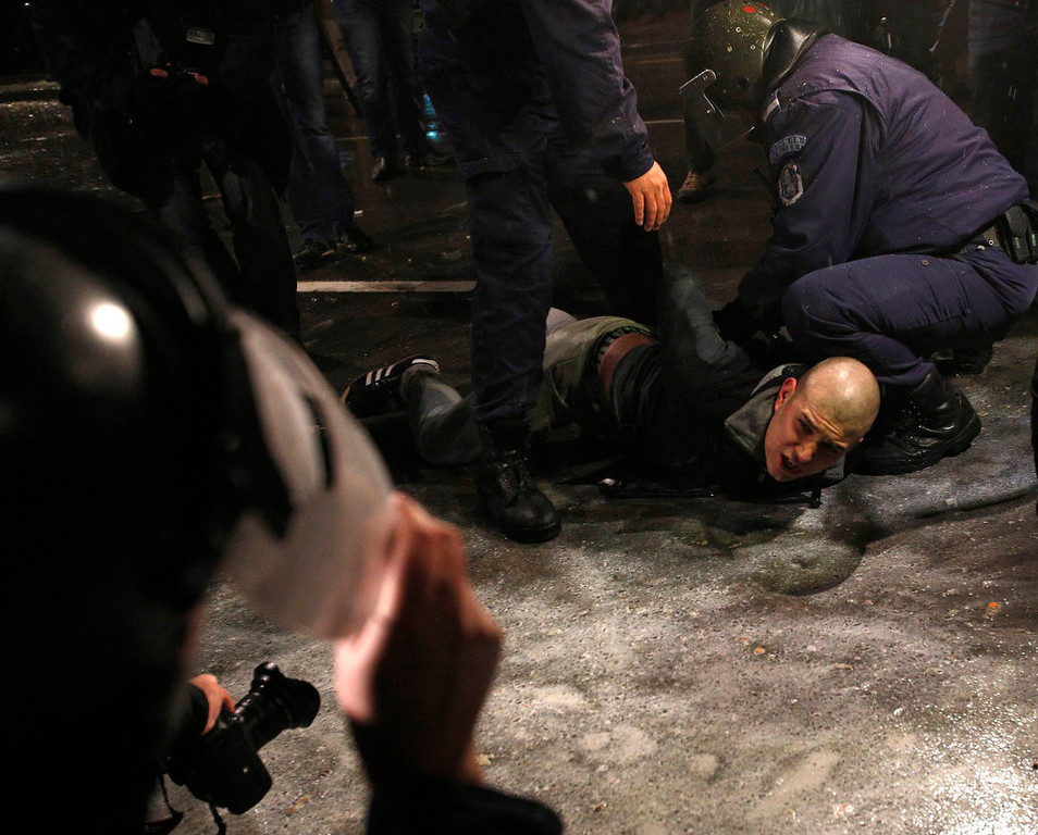 Description of . A man is detained by police during a protest against high electricity prices in Sofia February 19, 2013. Bulgaria\'s Prime Minister Boiko Borisov sought to calm mass protests on Tuesday by promising to slash electricity prices and punish foreign-owned power companies, setting Bulgaria on a collision course with EU partner the Czech Republic. REUTERS/Stoyan Nenov