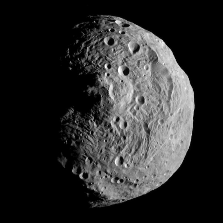 Description of . This image of the Asteroid Vesta, released by the Jet Propulsion Laboratory in Pasadena, Calif., Monday, July 18, 2011, was captured by the Dawn spacecraft on July 17, 2011. The image  was taken from a distance of about 9,500 miles (15,000 kilometers) away from the proto planet Vesta. (AP Photo/ NASA/JPL)