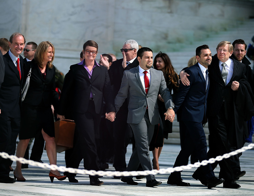 Description of . (L-R) Attorney David Boies, plaintiff couples Sandy Steier, Kris Perry, Paul Katami, Jeff Zarillo and attorney Ted Olson leave the U.S. Supreme Court after oral arguments, on March 26, 2013 in Washington, DC.  (Photo by Mark Wilson/Getty Images)