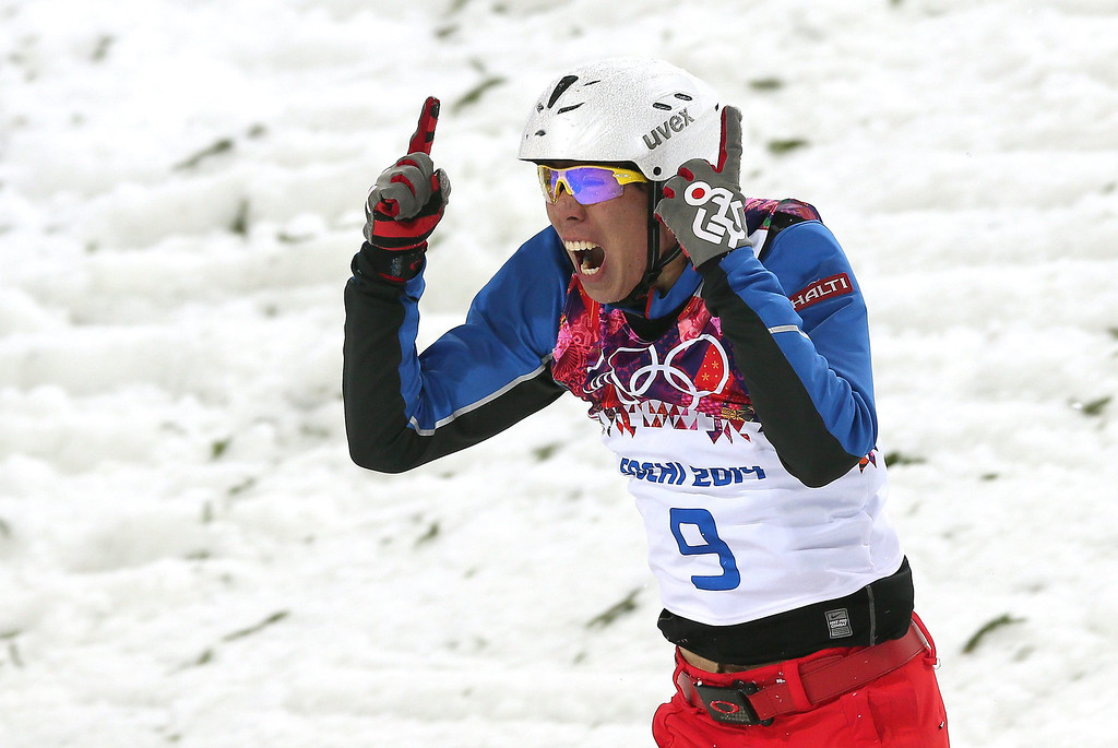 Description of . Bronze medalist Jia Zongyang of China reacts after he rolled on landing during the Men's Freestyle Skiing Aerials Final at the Rosa Khutor Extreme Park during the Sochi 2014 Olympic Games, Krasnaya Polyana, Russia, on Feb. 17, 2014. EPA/SERGEY ILNITSKY