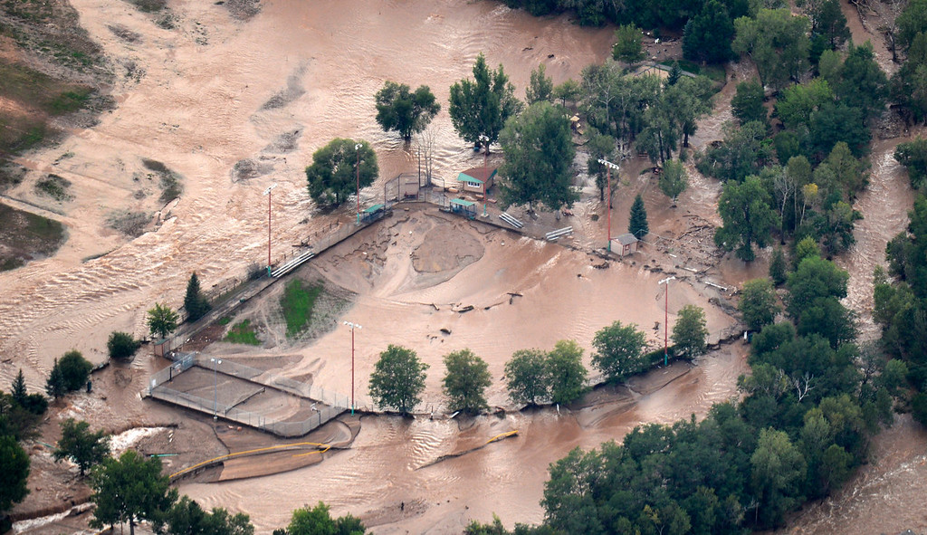 Description of . An aerial photograph shows the damage in Lyons from the flood, September 13, 2013. Massive flooding continues to hit Colorado. (Photo By RJ Sangosti/The Denver Post)