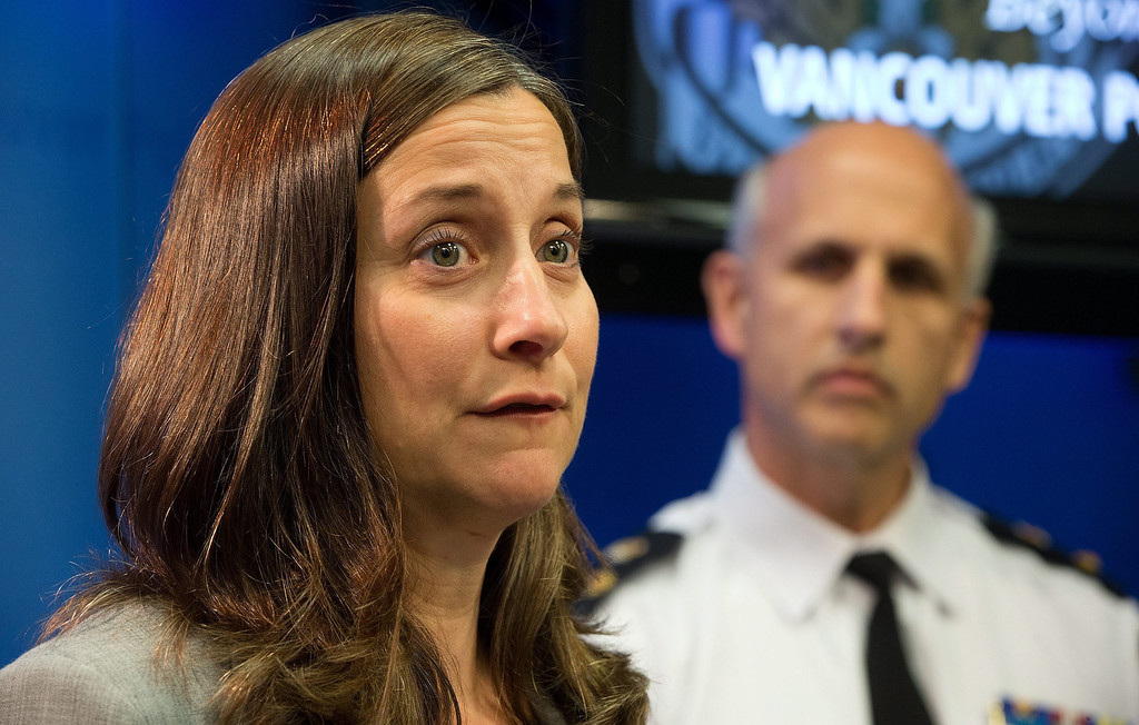 Description of . British Columbia Chief Coroner Lisa Lapointe speaks about the death of Canadian actor Corey Monteith as Vancouver Police Acting Chief Doug LePard, right, listens during a news conference in Vancouver, B.C., late Saturday July 13, 2013. Vancouver police say Canadian born actor Montieth, star of the hit show