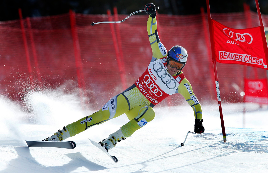 Description of . World Cup overall points leader Aksel Lund Svindal of Norway skis past a gate in the men's World Cup downhill ski race in Beaver Creek, Colorado, November 30, 2012. Svindal finished second in the race. REUTERS/Mike Segar