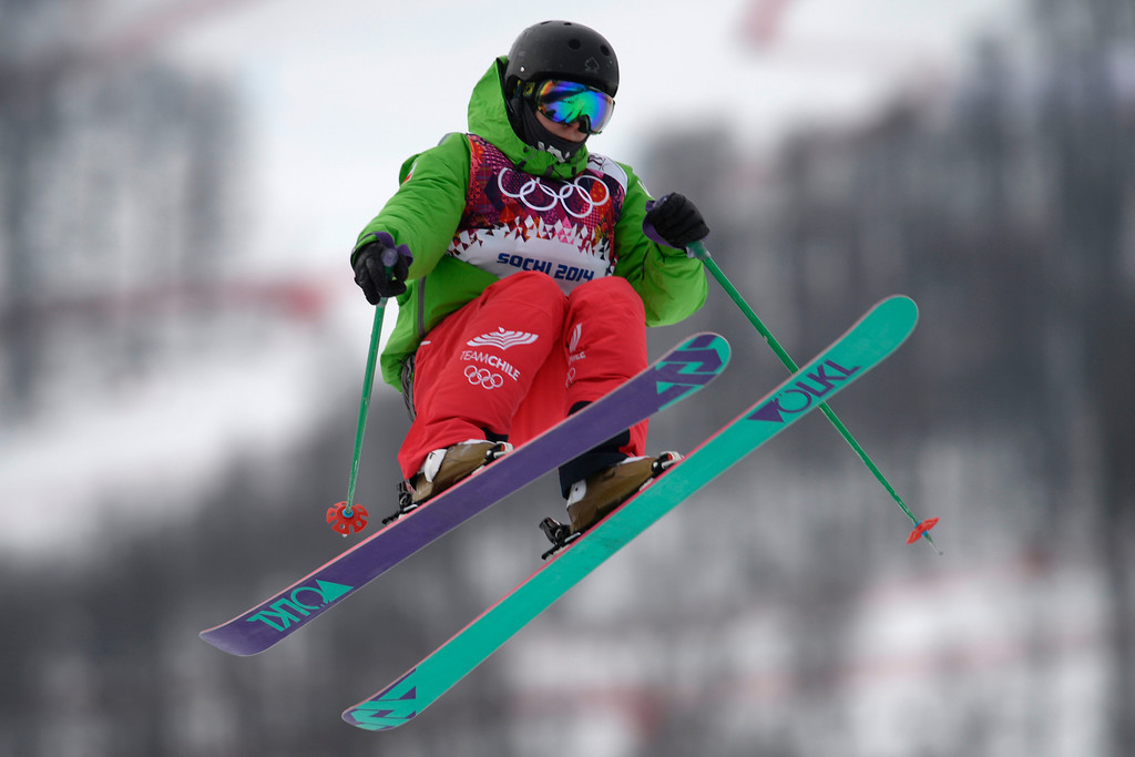 Description of . Devin Logan of the United States takes a jump during the women\'s freestyle skiing slopestyle final at the Rosa Khutor Extreme Park, at the 2014 Winter Olympics, Tuesday, Feb. 11, 2014, in Krasnaya Polyana, Russia. (AP Photo/Sergei Grits)
