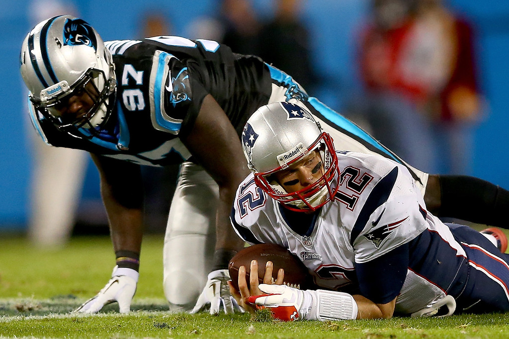 . Quarterback Tom Brady #12 of the New England Patriots reacts after he was sacked in the first half against the Carolina Panthers at Bank of America Stadium on November 18, 2013 in Charlotte, North Carolina.  (Photo by Streeter Lecka/Getty Images)