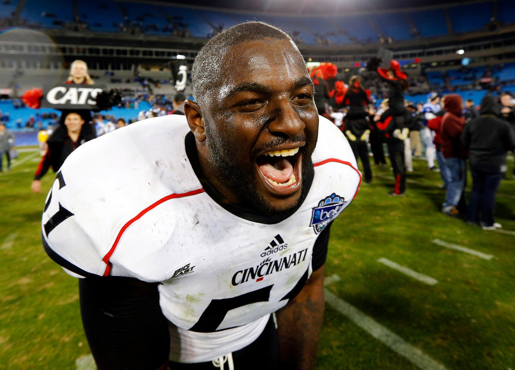 Description of . Cincinnati's Greg Blair (51) reacts after defeating Duke in the Belk Bowl NCAA college football game in Charlotte, N.C., Thursday, Dec. 27, 2012. Cincinnati won 48-34. (AP Photo/Chuck Burton)